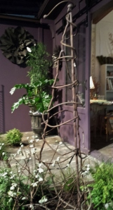 Rustic Tuteur.  Wouldn't a clematis look great on that?